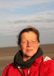 Profilbild von Kirsi Gembus am Strand von St. Peter Ording
